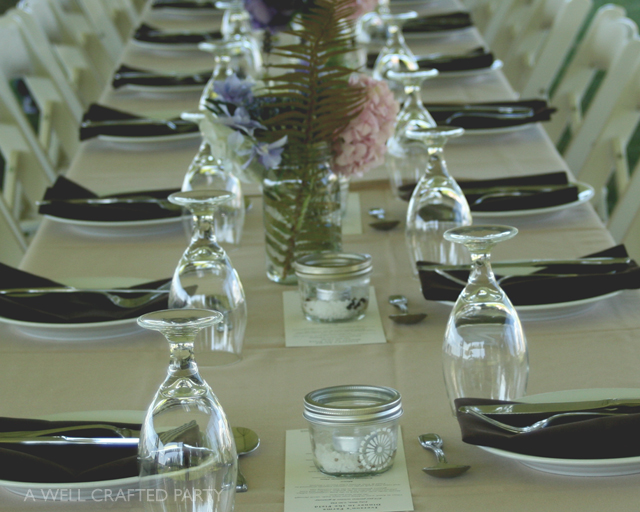 Simply decorated tables were lined with candles, dinner menus, and hydrangea arrangements.