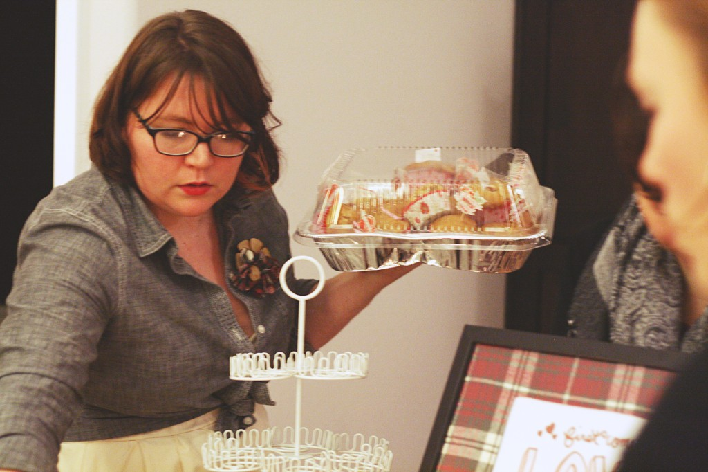 Putting out desserts that guests brought for our Valentine's Day Potluck. Photo by Motormouth Studios